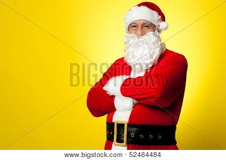 Saint Nick Posing Confidently Against Yellow Background