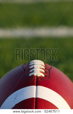 American Football Close Up with the Field Beyond