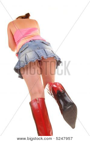 Woman In Skirt And Boots.