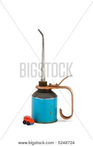 Old Oil Can With Toy Car