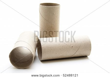 Grey cardboard roll on white background