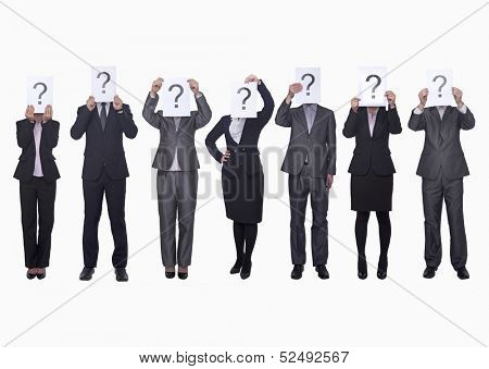 Medium group of business people in a row holding up paper with question mark