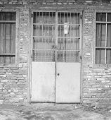 Front wall of old tenement house in black and white poster
