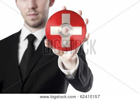 man holding cd swisse
