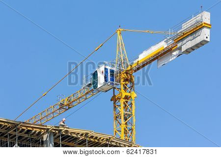 Crane On Construction Site Over Blue Sky