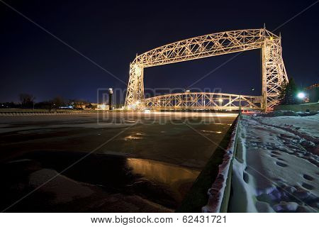 Lift bridge in Duluth Minnesota at night. Ice on the water, wintertime poster