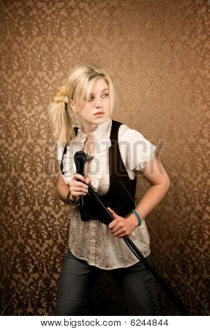 Pretty young singer or comedian with microphone and stand poster