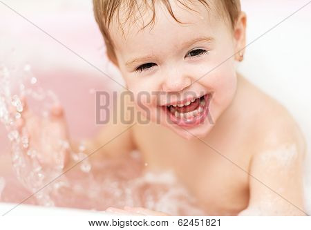 Happy Baby Girl Laughing And Bathed In Bath