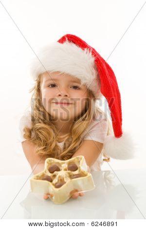 Happy Little Christmas Girl With Chocolate