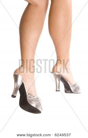 Back Of Woman's Legs And Silver Shoes