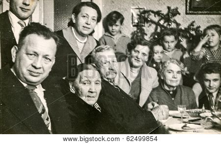 LODZ, POLAND, CIRCA 1950's: Vintage photo of people during a family dinner