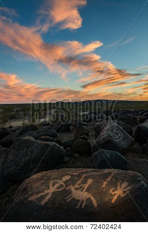 Colorful Clouds And Native American Rock Carvings
