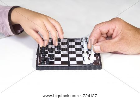 Boy And Grandfather Playing Chess