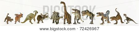 A Group Of Eleven Dinosaurs In A Row