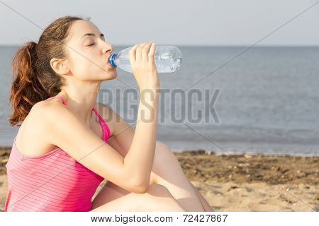Sports Woman Drinking Water Outdoors