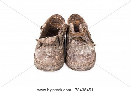 old brown boots isolated on white background