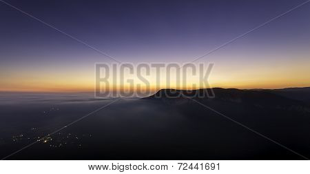 Sleepy Mountain Village With Peaks After Sunset