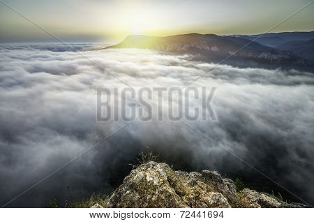 Sunset From The Top Of The Mountain Above The Clouds
