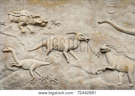 Dinosaurs bas relief on the wall, textured. poster