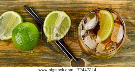 Cuba Libre Drink on a wooden table. Selective focus poster