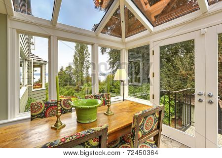 Sunroom Patio Area With Dining Table Set