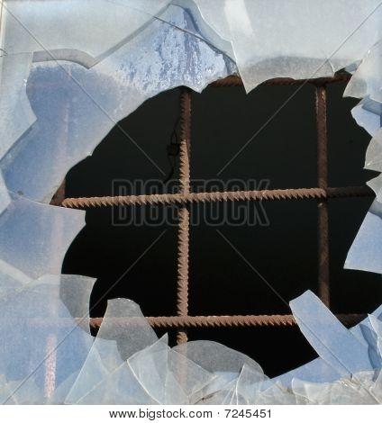 Iron Bars And Broken Glass Window