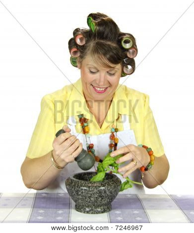 Housewife Crushing Herbs