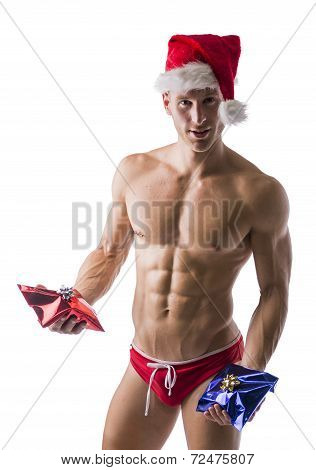 Muscular Man In A Speedo And Santa Claus Hat