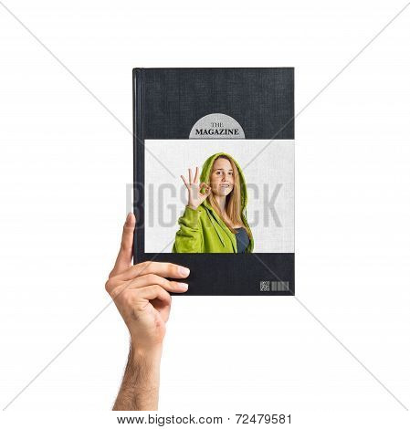 Young Woman Making Ok Sign Printed On Book