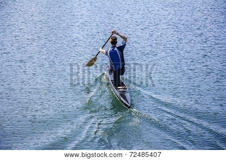 Man Rowing In A Canoe