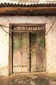 Hand crafted wooden door at Stone Town Zanzibar poster