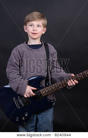 Young Boy Playing Guitar