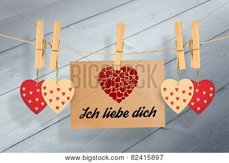 ich liebe dich against bleached wooden planks background