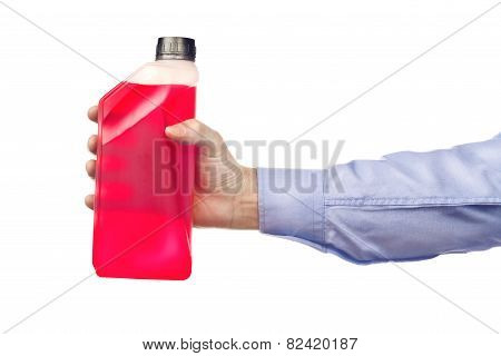 Hand Holding A Bottle Of Antifreeze