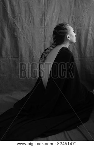 photo of beautiful woman praying on the floor. black and white photography