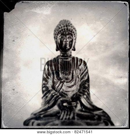 Instagram vintage filtered image of a Buddah