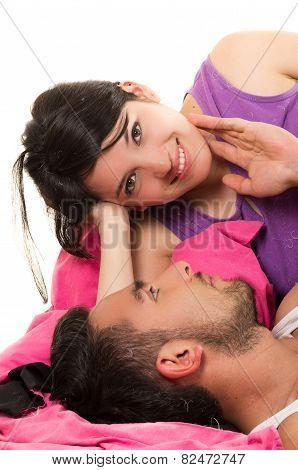 cute loving couple lying in bed wearing pijamas