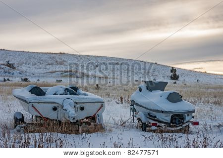 Snow-covered Boat And Jet Ski