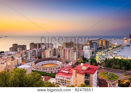 Malaga, Spain dawn skyline towards the Mediterranean Sea.