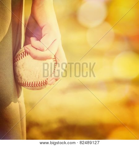 Boy holding a baseball ready to pitch.  Instagram effect.