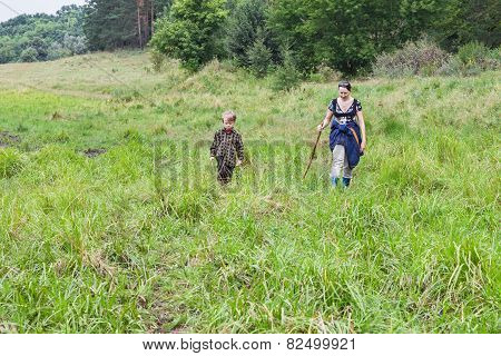 Grandmother With Grandson Striding Meadow