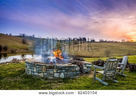 Bonfire in a fire pit at sunset in Central Kentucky countryside