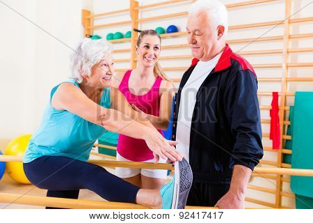 Senior at rehab in physical therapy having rehabilitation session