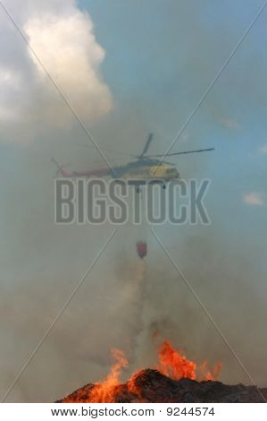 Fire Rescue Helicopter Draining Water Over Fire