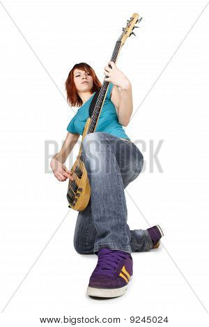 Young Beauty Redhead Girl Sitting On One Knee And Playing Bass Guitar, Full Body, Isolated