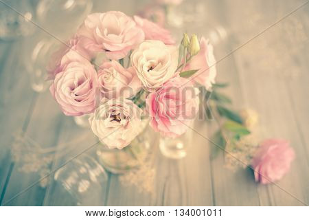 Gentle Vintage Bouquet of beautiful pink flowers on old wooden texture - still life