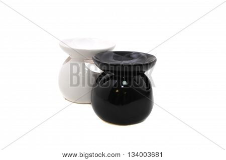 White and black ceramic vase candlesticks for aromatic oil isolated on the white background.
