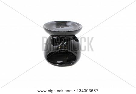 Black ceramic vase candlestick for aromatic oil isolated on the white background.