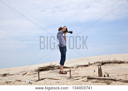 Boy Taking Pictures At The Beautiful Beach