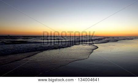 Beach at dusk in late summer, Huntington Beach, CA.